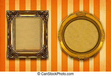 two gilded frames on striped background