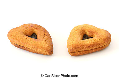 Two gingerbreads in heart shapes on white background facing each other