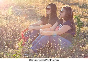 two girl in sunlight