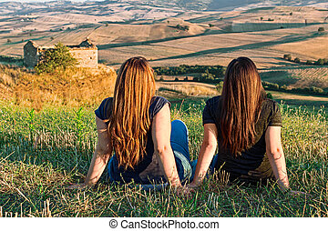 two girl on meadow