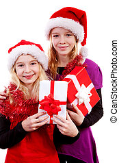Two girl with christmas hat and presents