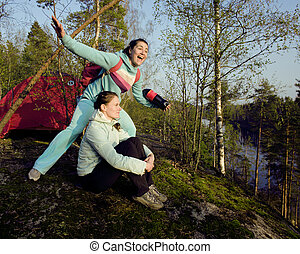 two girlfriend on top of mountain camping