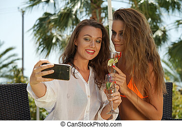 Two girlfriends making selfie