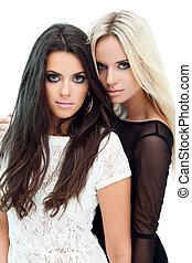 Two girlfriends - Two happy girlfriends posing on white...