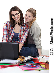 two girlfriends studying together