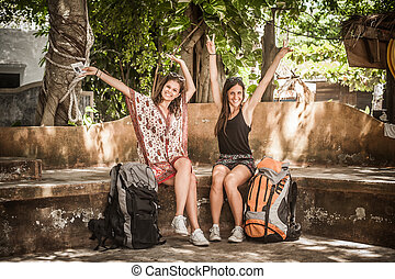 Two girlfriends with backpack enjoying on summer vacation