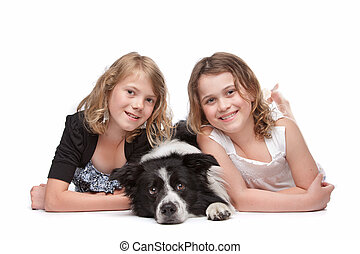 Two girls and a dog
