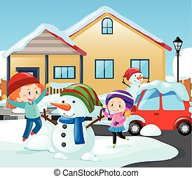 Two girls and snowman in front of the house
