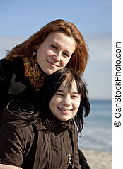 Two girls at beach.