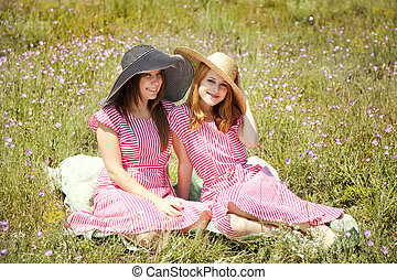 Two girls at contryside.