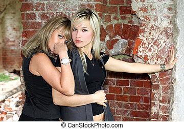 two girls at old brick wall