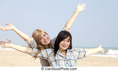 Two girls at outdoor near sea