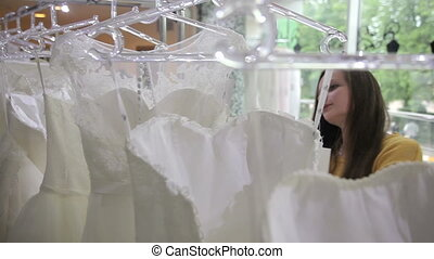 Two girls choosing a wedding dress