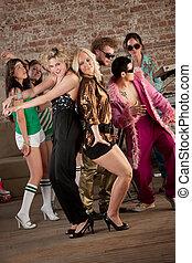 Two girls dancing - Two pretty blonde girls dancing with...