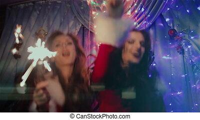 Two girls dancing with Christmas lights