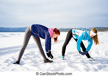 Two girls doing aerobics exercises