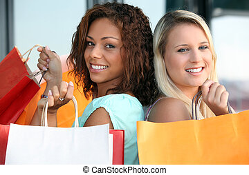 two girls doing shopping