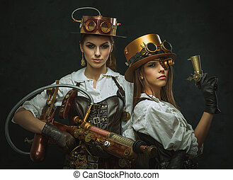 Two girls dressed in the style of steampunk with arms.