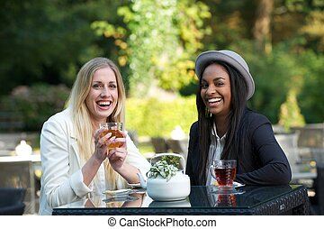 Two Girls Drinking Tea