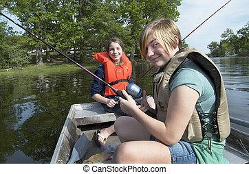 Two Girls Fishing In Boat