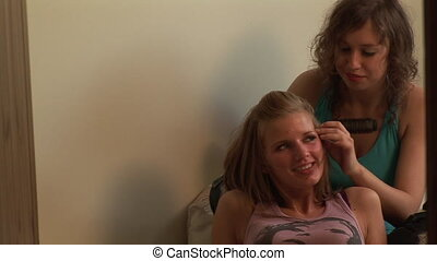 Two Girls having fun Combing hair - Two girls having fun...