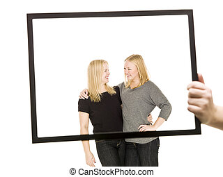 Two girls in a frame