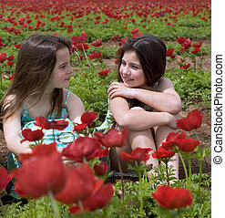two girls in a red field