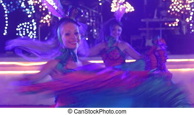 two girls in cabaret costumes dance cancan - two young girls...