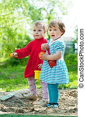 two  girls  in sandbox