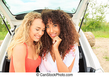 Two girls in the back of the car