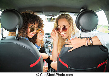 Two girls in the car with glasses - Two girls in the car...