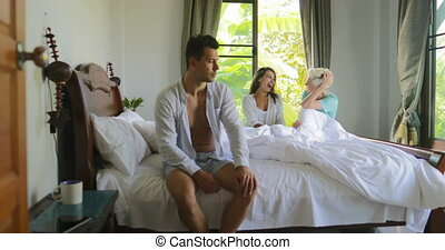Two Girls Laughing From Man Sitting In Bed, Young Women And...