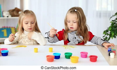 Two girls learn to paint. DOLLY HD