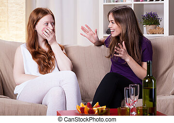 Two girl's meeting - Two girls at meeting, chatting and...