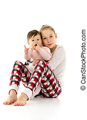 two girls of different ages in the studio on a white background.