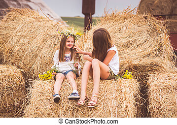 Two girls on a field
