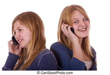two girls on cell phones - Two teen girls on their cell...