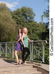 Two girls on the bridge
