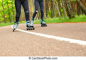 Two girls on the roller skates