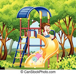Two girls on the slide in park