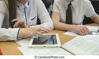 Two girls play in game using a electronic tablet