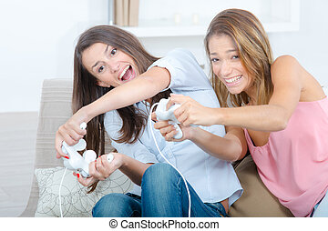 Two girls playing computer game