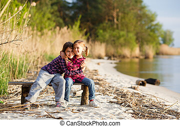 Two girls playing on the beach