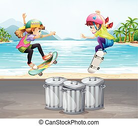 Two girls playing skateboard by the beach