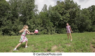 Two girls playing with the ball