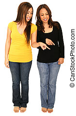 Two Girls Pointing At Ground