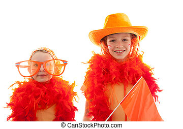 Two girls posing in orange outfit