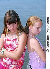 Two girls pouting - Two preteen girls pouting