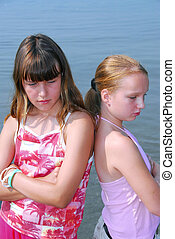Two girls pouting - Two preteen girls pouting