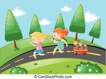 Two girls pulling wagon on the road
